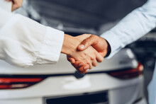 Car Seller And Buyer Handshake...
