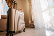 Travel Suitcase Stands In A Wh...