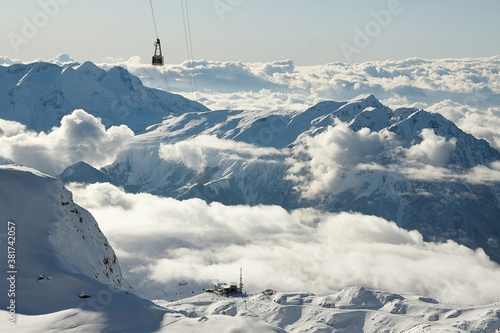 Ski lift cabins in snowy mountains in Les 2 Alpes Canvas Print