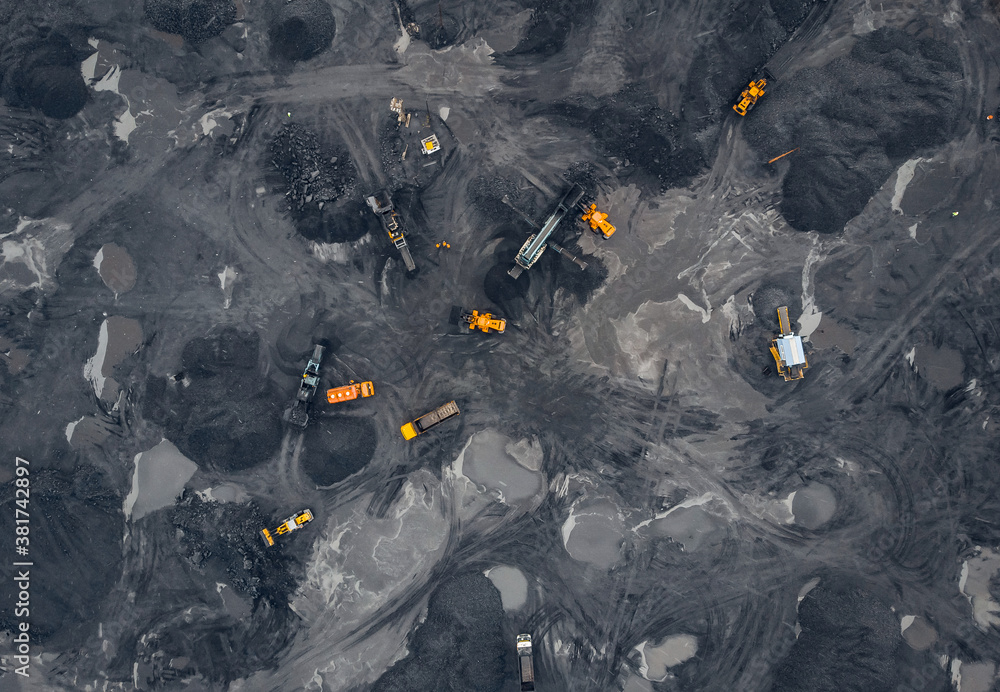 Fototapeta Coal mining an open pit extractive industry, top view aerial