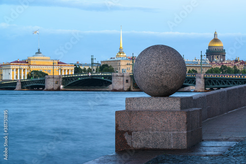 Photo Granite stone ball on Vasilyevsky island, St Isaac's Cathedral and the Admiralty