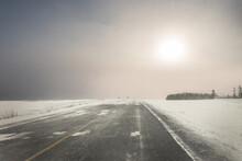 An Asphalt Road Heading Toward...