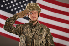 Male Soldier Saluting Against American Flag. Military Service
