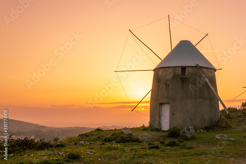 Fototapety, obrazy: Lanscape with one old windmill by amazing sunset , in Coimbra , Portugal