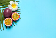 Passion Fruits (maracuyas), Flower And Palm Leaf On Light Blue Background, Flat Lay. Space For Text