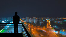The Man Standing On The Balcon...