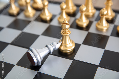 Photo Chess pieces in a duel on a chess board