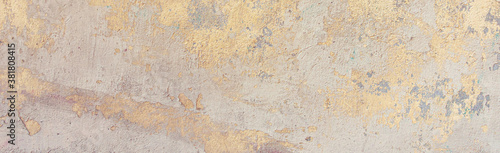Obraz Old cracked weathered painted wall background texture. Yellow dirty peeled plaster wall with falling off flakes of paint. Abstract grunge uneven surface with scratches and cracks - fototapety do salonu
