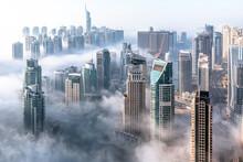 Aerial View Of Dubai Skyline. Morning Mist Hovering Dubai Marina