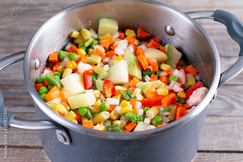 Fotografering Mix of vegetables, cooked in saucepan