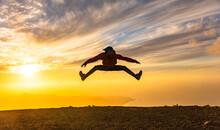Happy Man Jumping For Joy At S...