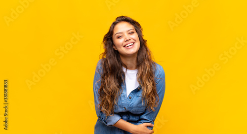 laughing shyly and cheerfully, with a friendly and positive but insecure attitu Canvas Print