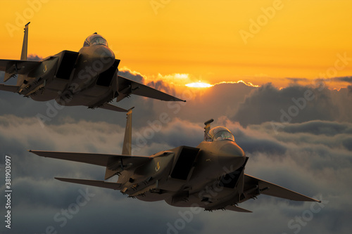 Boeing F-15E Strike Eagle formation flying above the clouds