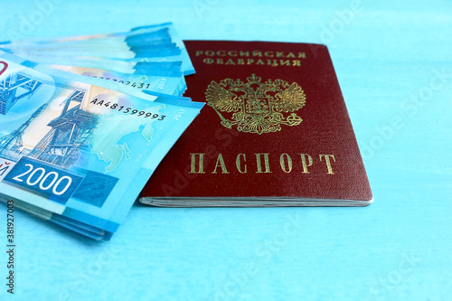 Fototapety, obrazy: Passport of a citizen of the Russian Federation and money denomination 2000 two thousand rubles.