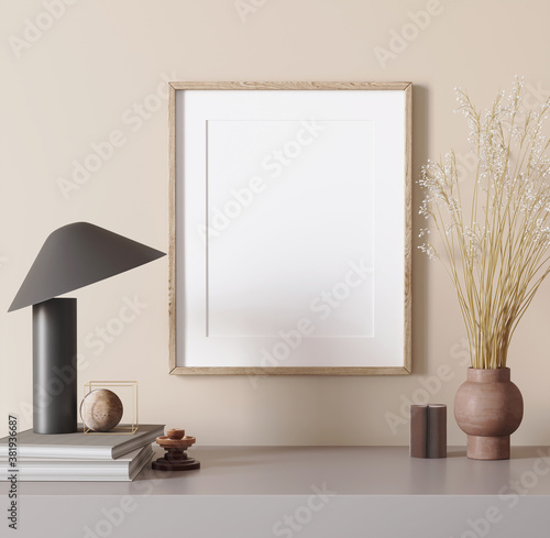 Fototapeta 3d render of a modern beige mockup interior with wooden frame on an empty beige wall a black table lamp and a pampas grass obraz