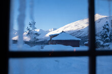 Snow Covered Cottages And Moun...