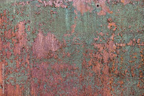 Cuadros en Lienzo Green and orange rusting decaying metal texture with peeling paint