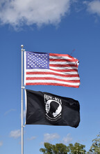 American Flag And POW MIA Flag In The Wind