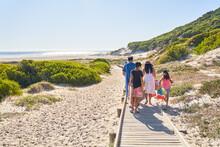 Family Walking On Sunny Beach ...