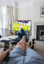 POV Man Watching Soccer Match On TV In Living Room