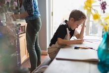 Focused Boy Homeschooling At K...