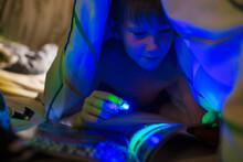 Boy With Black Light Reading M...