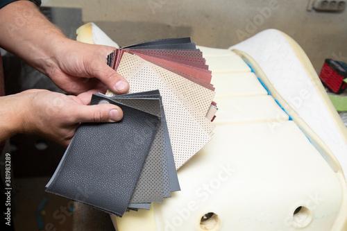 Fotografie, Obraz Repair of car seats and steering wheels. Car interior repairs.