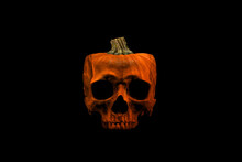 Front View Of A Spooky Skull Isolated On Black Background. Pumpkin With Skull Face. Fall Autumn Halloween Concept.