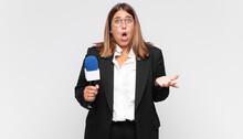 Young Woman Reporter Feeling E...
