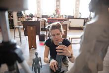 Female Artist Shaping Sculptur...
