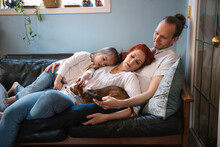 Affectionate Family With Dog C...