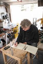 Male Carpenter Sketching Plans...