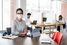 Woman And Coworkers In Face Ma...