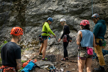 Young Friends Preparing Rock Climbing Equipment