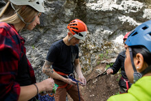 Young Man Teaching Rock Climbing Lesson