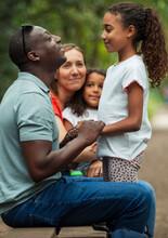 Happy Family Talking On Park B...