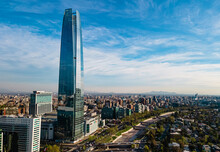 The Tallest Building In Chile At A Sunny Day With A Park And A River By The Side. The Financial Center Of The City