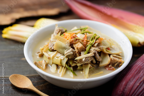 Photo Northern Thai food (Kaeng Hua Plee), banana flower spicy soup with pork in a bow