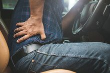 Man Use Hands Hold And Massage On His Back In The Car While Stop. Outdoor Shooting For Transport And Healthcare