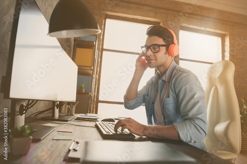 Profile side view portrait of his he nice busy friendly guy typing consulting client remotely tech support ip address cyberspace at modern industrial interior style concrete wall work place station