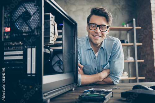 Obraz Close-up portrait of his he nice attractive cheerful practitioner guy expert specialist technician repairing hardware home-based company at modern loft industrial home office work place station - fototapety do salonu