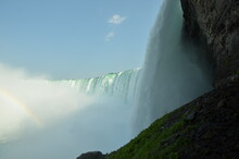 View Behind The Canadian Niagara Falls And Rainbows In The Haze Of The Waterfalls In The Background