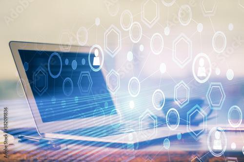 Fotografie, Obraz Computer on desktop with social network hologram
