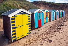 Row Of Beach Huts Along Saunto...