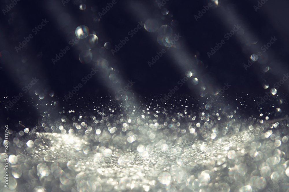 Fototapeta background of abstract silver and black glitter lights. defocused