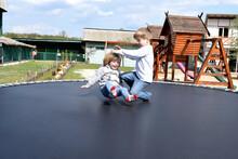 Children Playing On A Trampoli...