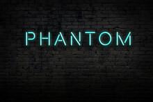 Neon Sign. Word Phantom Against Brick Wall. Night View