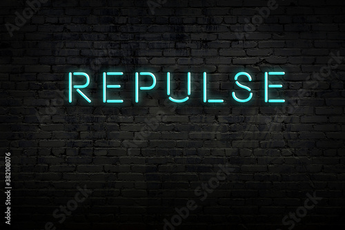 Fotografering Neon sign. Word repulse against brick wall. Night view