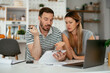 Husband and wife preparing bills to pay. Young couple having financial problems.