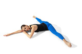 Sport. Beautiful young female athlete stretching, training on white studio background, portrait with shadows. Sportive fit model in motion and action. Flexibility, healthy lifestyle, style concept.